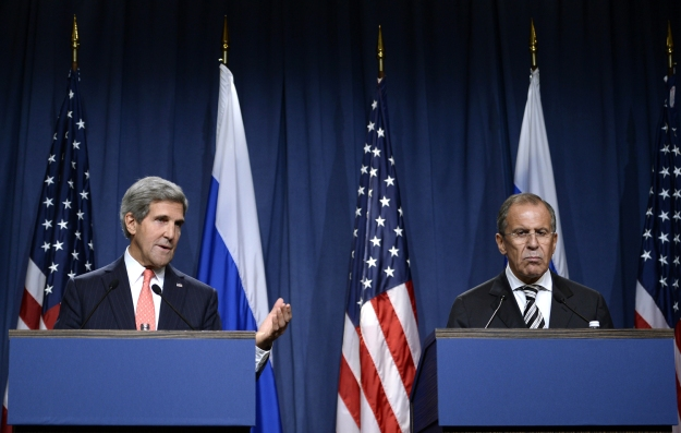 Philippe Desmazes / AFP - Getty Images Secretary of State John Kerry, left,  holds a joint press conference with Russian Foreign Minister Sergey Lavrov in Geneva on Saturday to discuss the agreement they reached on eliminating Syria's chemical weapons.