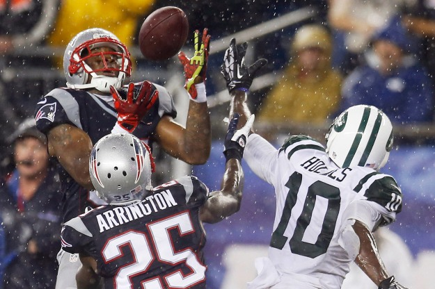 Patriots cornerback Aqib Talib intercepts a pass intended for Jets wide receiver Santonio Holmes (10). Photo: AP