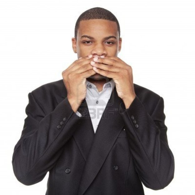 8053186-isolated-studio-shot-of-an-african-american-businessman-in-the-speak-no-evil-pose